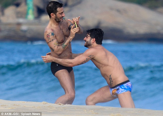 Designer Marc Jacobs jets to Rio to celebrate his 49th birthday inside the